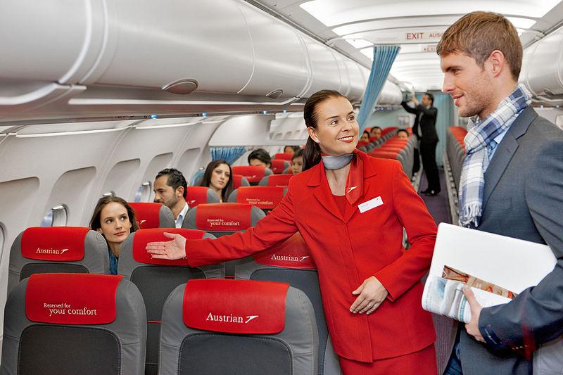 Name:  Austrian_Airlines_flight_attendant_and_passenger.jpg Views: 64 Size:  91.2 KB