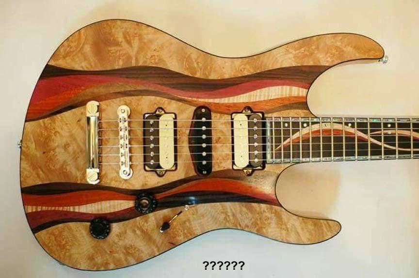 Name:  guitarunknown.jpg Views: 76 Size:  63.2 KB
